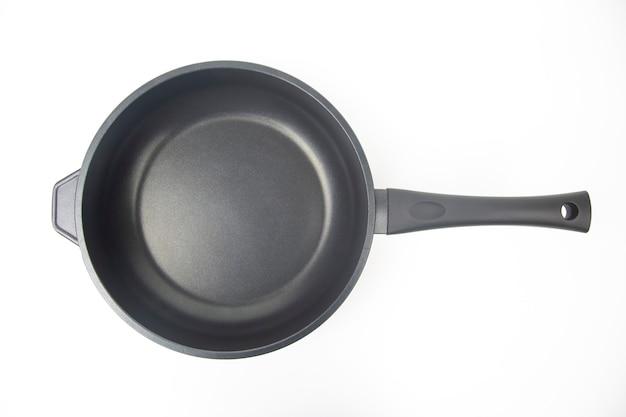 Frigideira preta com revestimento antiaderente de teflon branco