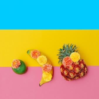 Frutas tropicais em flores. arte de frutas com achatamento mínimo