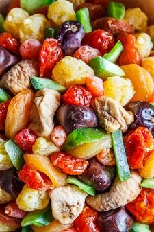 Frutos secos e frutas cristalizadas fundo.