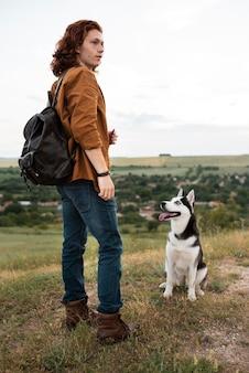 Full shot man e cute husky