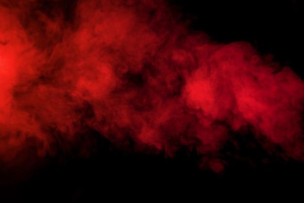 Fumaça vermelha em fundo preto