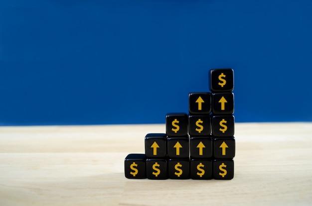 Fundação de forma de crescimento de blocos pretos com cifrão e setas apontando para cima sobre eles em uma imagem conceitual