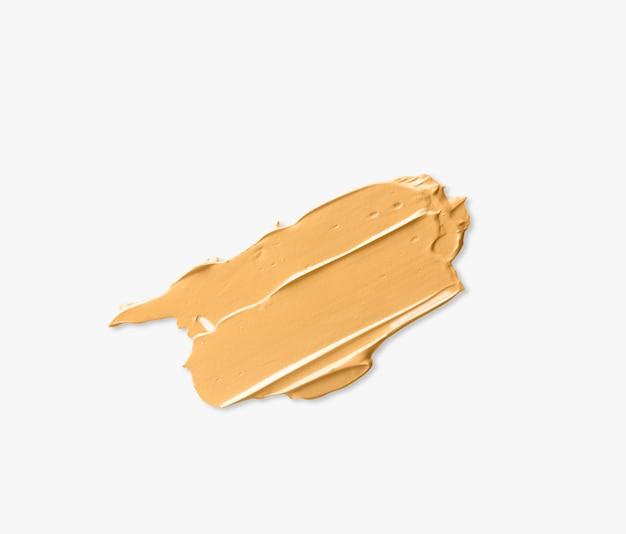 Fundação manchada isolada no fundo branco, cosméticos de rosto de amostra.