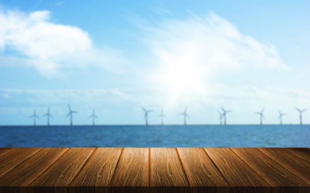 Fundo 3d de uma mesa de madeira com vista para um parque eólico no mar