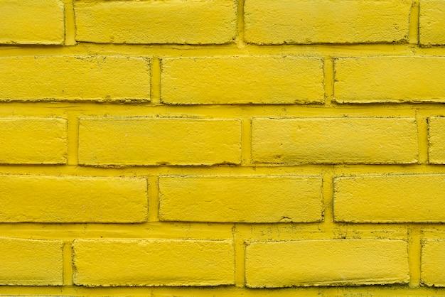 Fundo abstrato amarelo da parede de tijolo