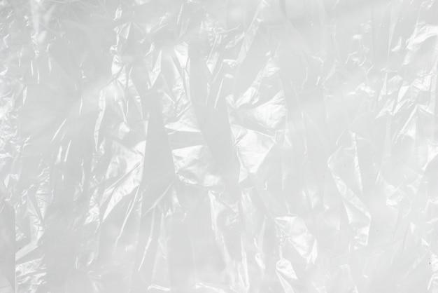 Fundo abstrato amassado saco de lixo branco de textura de filme plástico