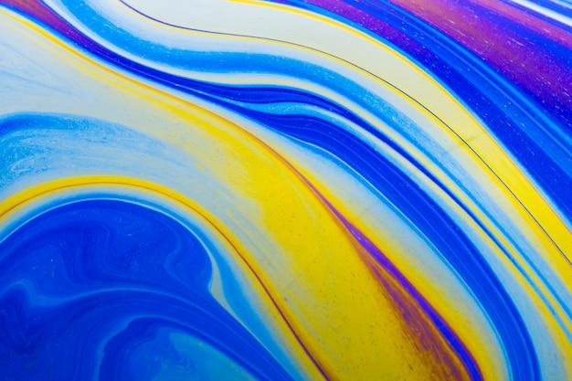 Fundo abstrato azul e amarelo ondulado reluzente
