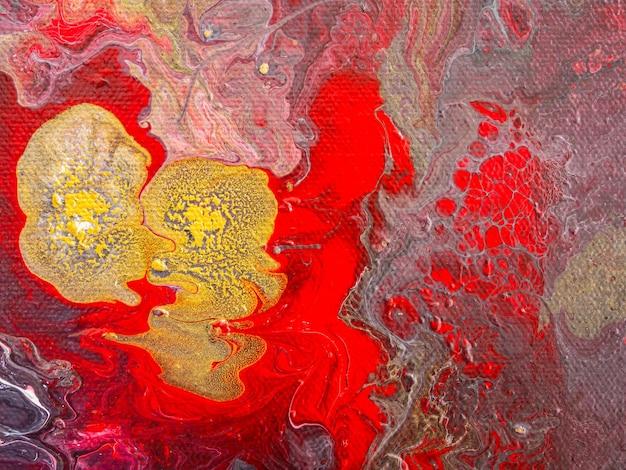 Fundo abstrato bonito. derramando tinta acrílica sobre tela. arte contemporânea.