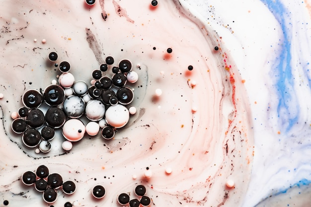 Fundo abstrato colorido. bolhas de tinta na água. pintura colorida abstrata. foto macro