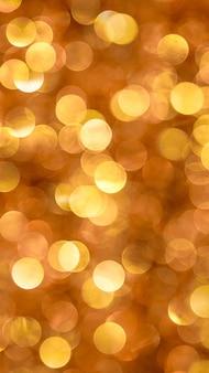 Fundo abstrato com bokeh grande laranja e dourado