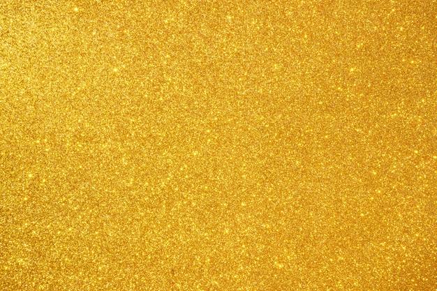 Fundo abstrato com brilho dourado e brilhante bokeh
