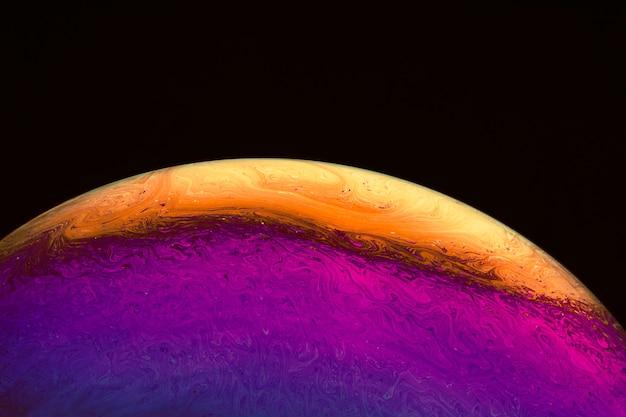Fundo abstrato com esfera roxa e laranja
