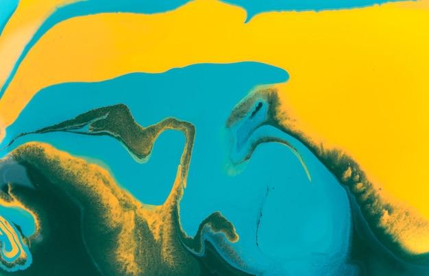 Fundo abstrato com manchas de tinta amarela e azul