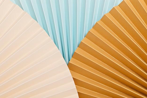 Fundo abstrato com ventiladores de papel texturizado. celebração festiva