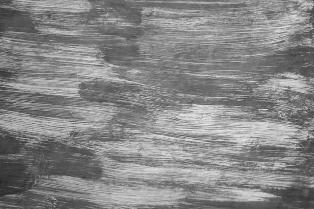 Fundo abstrato, cor preta pintada na parede branca, curso da escova da arte.