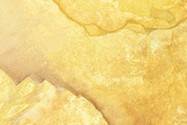 Fundo abstrato da parede concreta amarela velha da textura com grunge e rachado.
