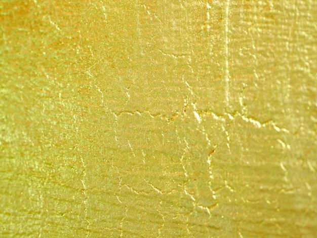 Fundo abstrato da parede da cor do ouro.