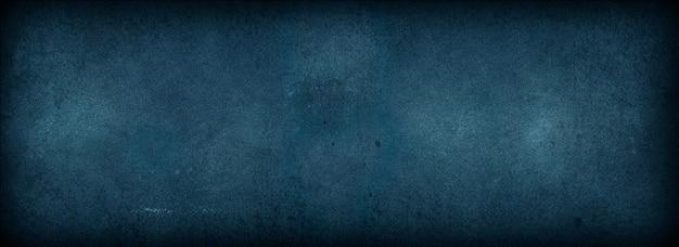 Fundo abstrato da parede escura decorativa do grunge. fundos de concreto azul escuro com textura áspera, papel de parede escuro, espaço para texto, uso para papel de parede de quadros de banner de página da web de design decorativo