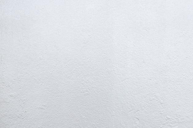 Fundo abstrato da textura concreta branca com luz no tom brilhante.