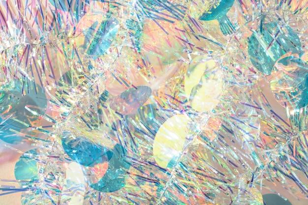 Fundo abstrato da textura da festão do natal dos confetes coloridos.