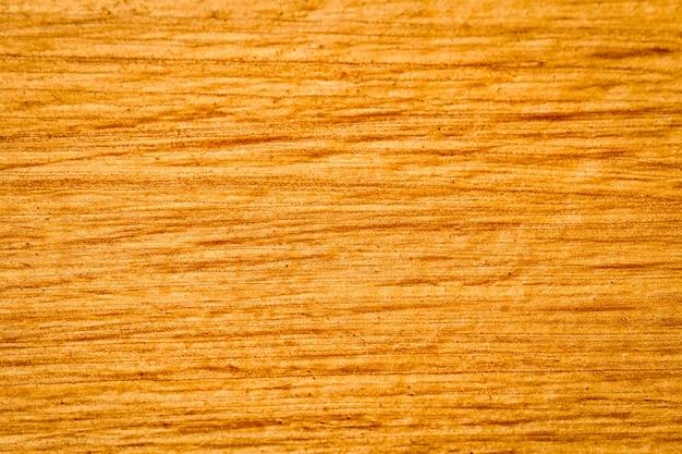 Fundo abstrato da textura da madeira do ouro para o fundo da web