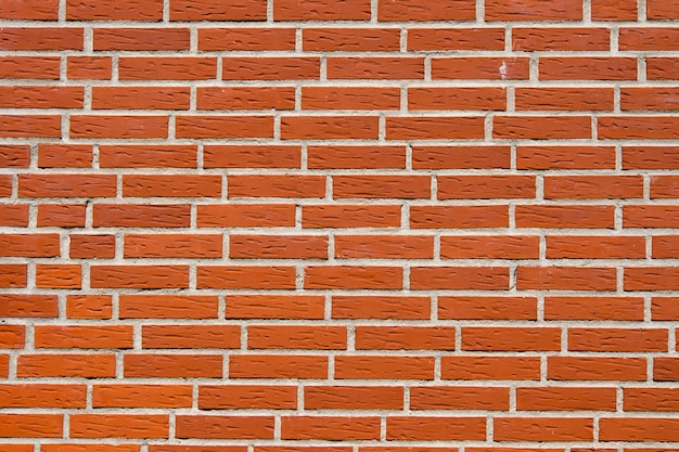 Fundo abstrato da textura da parede de tijolo vermelho.