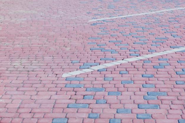 Fundo abstrato da velha vista do pavimento de paralelepípedos de cima.