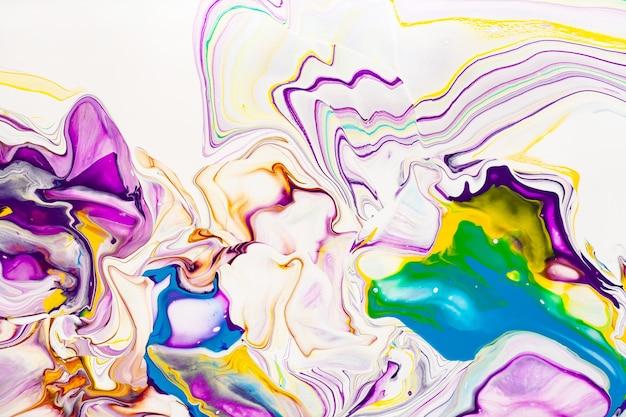 Fundo abstrato das ondas da pintura acrílica. textura de mármore do arco-íris. papel de parede colorido do fluxo de líquido de tinta a óleo. pano de fundo criativo de efeito fluido de violeta, amarelo e azul.