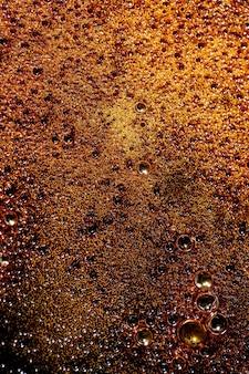 Fundo abstrato de caramelo derretido marrom. macro. vista superior, configuração plana. copie o espaço