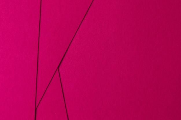 Fundo abstrato de composição geométrica rosa com papelão de textura