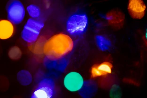 Fundo abstrato de luzes circulares em amarelo e azul