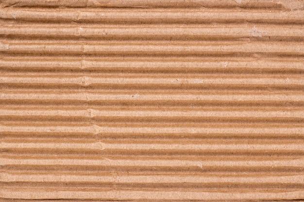 Fundo abstrato de papelão rasgado. um pedaço de papel ondulado grosso