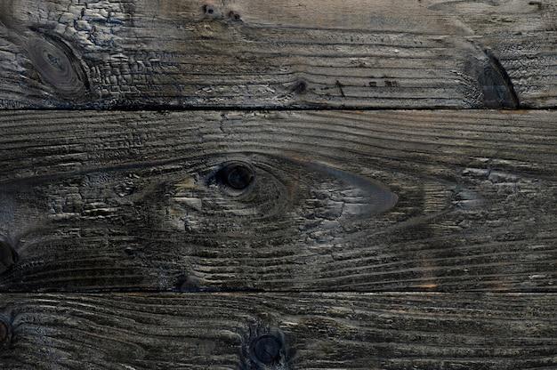 Fundo abstrato de placas de madeira queimadas com vista panorâmica para obras de arte
