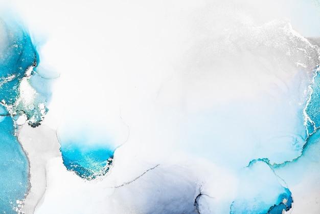 Fundo abstrato de prata azul da pintura artística de tinta líquida de mármore no papel.