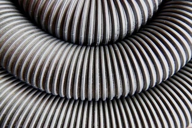 Fundo abstrato de tubo corrugado