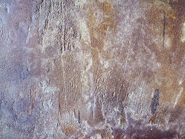 Fundo abstrato do grunge do estilo velho marrom do sótão da parede do cimento.
