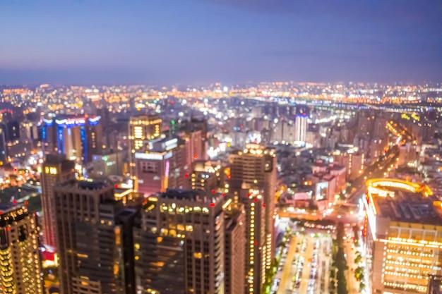 Fundo abstrato do horizonte da cidade à noite em vista aérea, profundidade de foco rasa