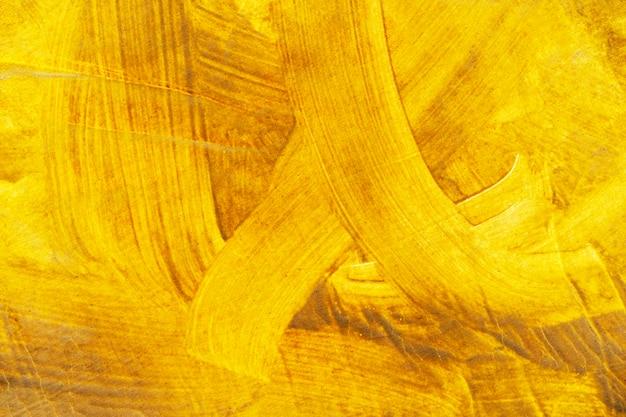 Fundo abstrato do ouro e da cor amarela pintados na parede. cenário retrô e vintage.