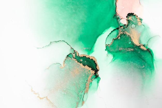 Fundo abstrato do ouro verde da pintura da arte de tinta líquida de mármore no papel.