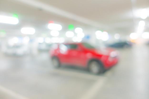 Fundo abstrato do parque de estacionamento do borrão.