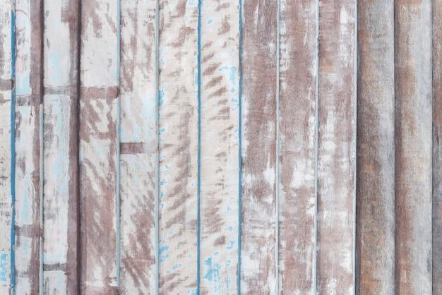 Fundo abstrato do teste padrão de madeira velho da prancha com pintado e riscado.