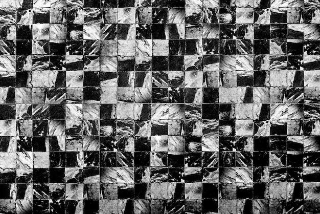 Fundo abstrato do teste padrão de mármore escuro na parede.