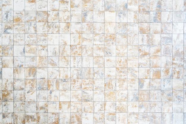 Fundo abstrato do teste padrão velho do tijolo na passagem.