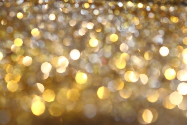 Fundo abstrato dourado bokeh com brilhantes brilhos de desfocagem