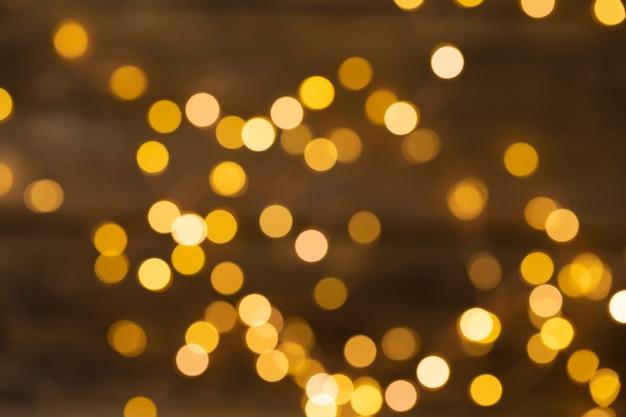 Fundo abstrato dourado do feriado das luzes desfocadas