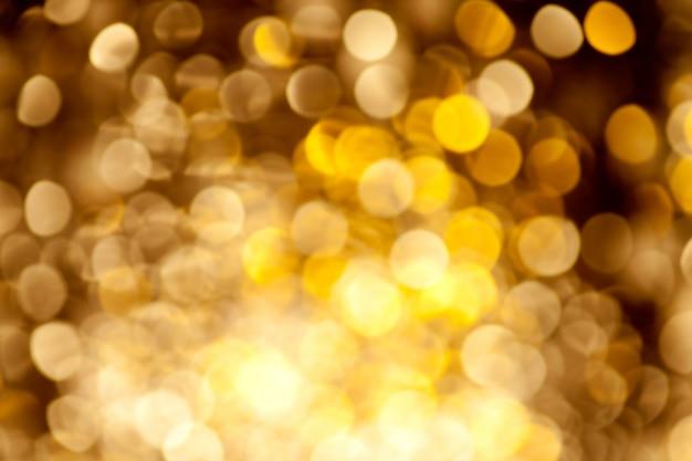 Fundo abstrato dourado luzes desfocadas