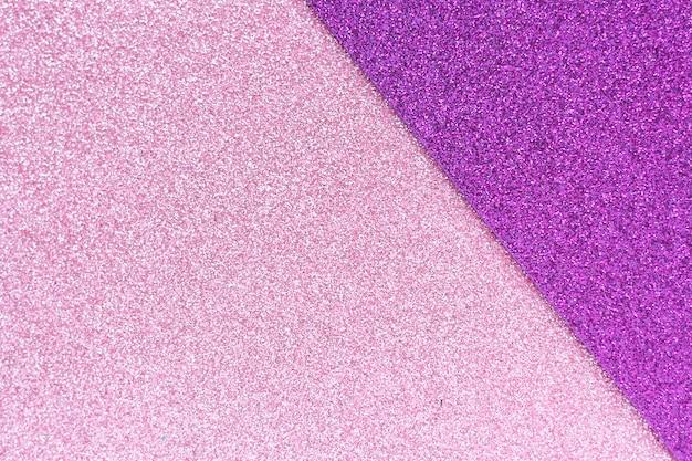 Fundo abstrato e textura do papel gliter rosa e roxo. espaço para texto.