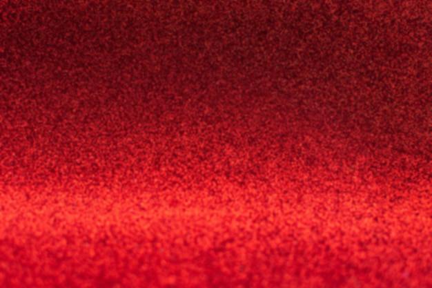 Fundo abstrato glitter vermelho com desfoque