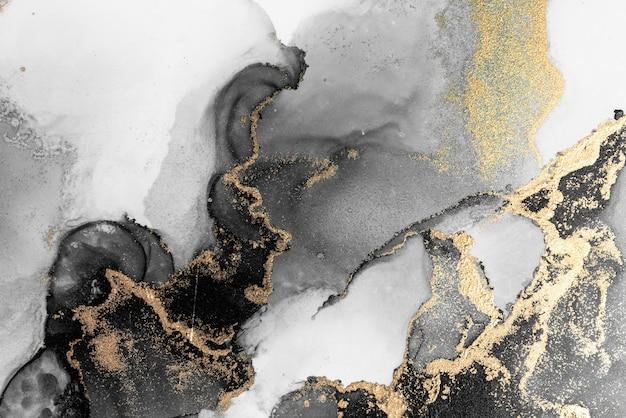 Fundo abstrato ouro preto da pintura artística de tinta líquida de mármore no papel.