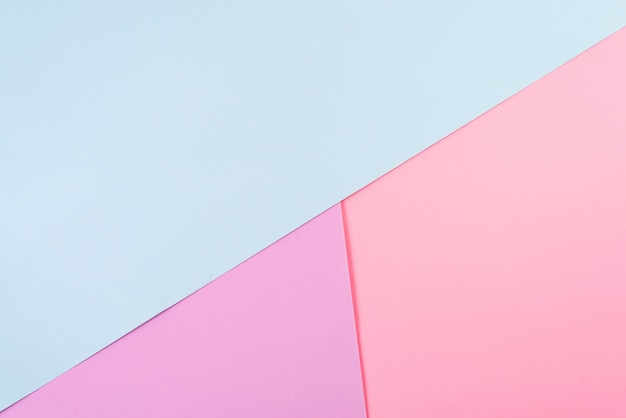 Fundo abstrato papel geométrico. cores da tendência azul rosa.